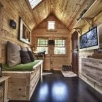 Shipping container home with pallet wood interior. Awesome uses for shipping containers.